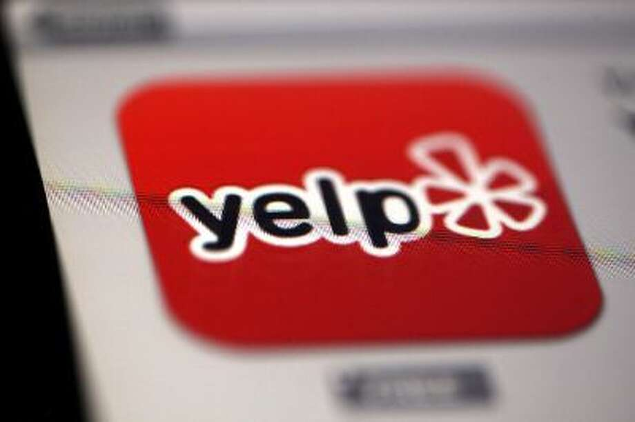 Yelp.com is one of several e-commerce sites that pays for lobbyists on Capitol Hill. Photo: Bloomberg Via Getty Images / 2013 Bloomberg