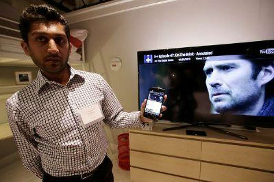 Suveer Kothari of Google demonstrates how a Chromecast media device can transfer web content from his Android device directly to a television at Dogpatch Studios in San Francisco, Calif. on Wednesday, July 24, 2013. (Gary Reyes/Bay Area News Group) Photo: San Jose Mercury News / San Jose Mercury News