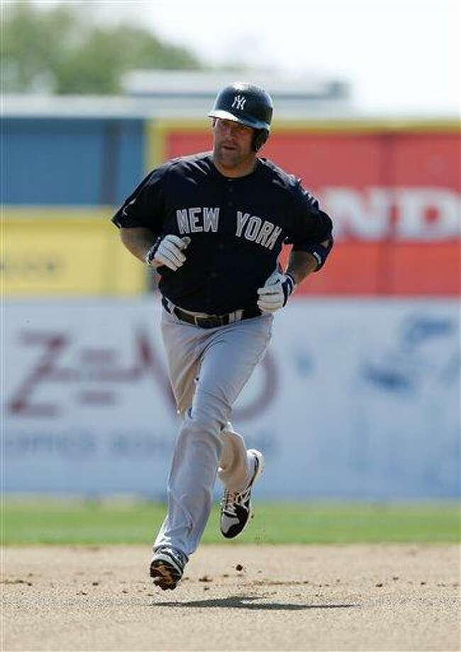 New York Yankees Kevin Youkilis runs the bases on a solo home run in a spring training baseball game in Dunedin, Fla., Thursday, March 14, 2013.  (AP Photo/Kathy Willens) Photo: ASSOCIATED PRESS / AP2013