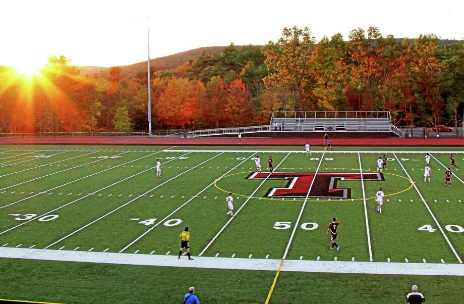 The sun sets over the new turf field at Torrington High School Wednesday during a boys soccer game against Naugatuck. The field officially opens Saturday with a ribbon cutting at 2:15 p.m. Photo: Marianne Killackey — Special To The Register Citizen   / 2014