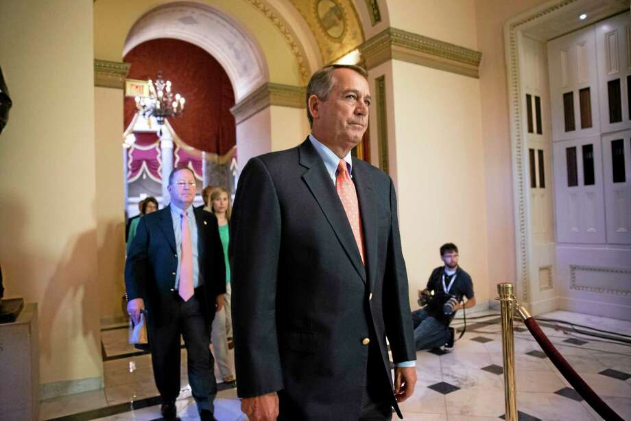 Speaker of the House John Boehner, R-Ohio, walks to the chamber as lawmakers vote to pay federal workers who have been furloughed during the government shutdown, at the Capitol in Washington, Saturday, Oct. 5, 2013. Photo: J. Scott Applewhite—The Associated Press  / AP