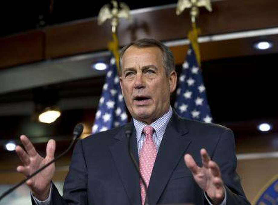 """This photo taken March 7, 2013 shows House Speaker John Boehner of Ohio meeting with reporters on Capitol Hill in Washington. Boehner says former Republican colleague Bob Ney is a disgraced congressman who went to jail and that Ney's criticisms of Boehner in a new book are """"baseless and false.""""Boehner was asked at a news conference Thursday about Ney's reported accusations in his book that Boehner was more interested in playing golf and drinking than making policy and that in 2006 Boehner had reneged on a promise to get him a job if Ney left Congress. Boehner says Ney is making false statements in order to sell his book. Boehner said, quote, """"It's sad."""" Like Boehner, Ney is an Ohio Republican. Ney spent 11 months in prison for his involvement in the Jack Abramoff lobbying scandal. (AP Photo/J. Scott Applewhite) Photo: AP / AP"""