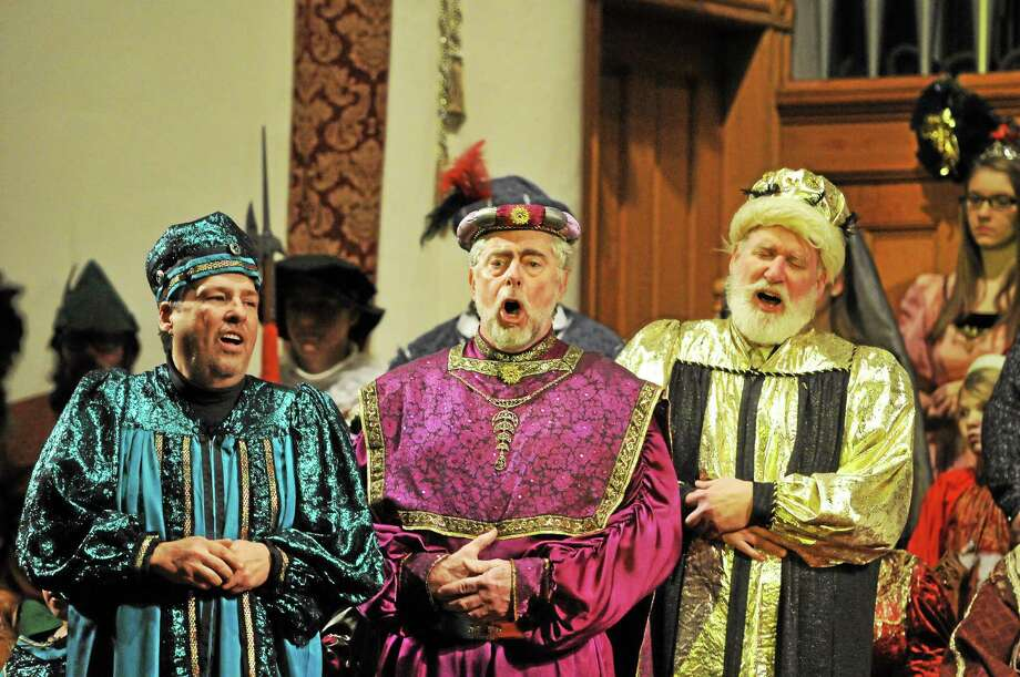 Dave Pastorello, portraying Melchior, Dave Lewis, portraying Caspar, and the Rev. Tim Yeadon, portraying Balthazar, perform as the Three Kings during the 24th annual Boar's Head festival in Winsted on Saturday. Photo: Laurie Gaboardi—Register Citizen