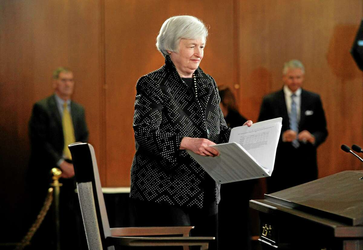 Federal Reserve Chair Janet Yellen arrives for a news conference at the Federal Reserve in Washington, Wednesday, June 18, 2014. A stay-the-course message is expected from the Federal Reserve on Wednesday after it ends a two-day policy meeting. The Fed will likely approve a fifth cut in its monthly bond purchases because the job market has steadily strengthened. But no clear signal is expected on when the Fed will start raising short-term interest rates from record lows. (AP Photo/Susan Walsh)