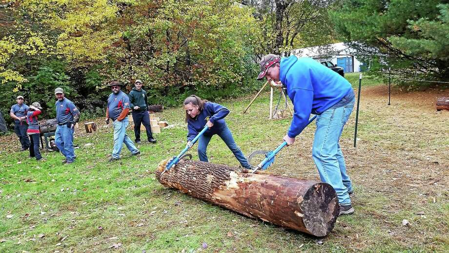 Photo by N.F. Ambery Carley Mae Bordner, 16, of Thomaston and Mark Sniffen, 14, of Litchfield compete in the log-rolling competition at the Warren Fall Festival at 255 Brick School Road on Saturday. Photo: Journal Register Co.