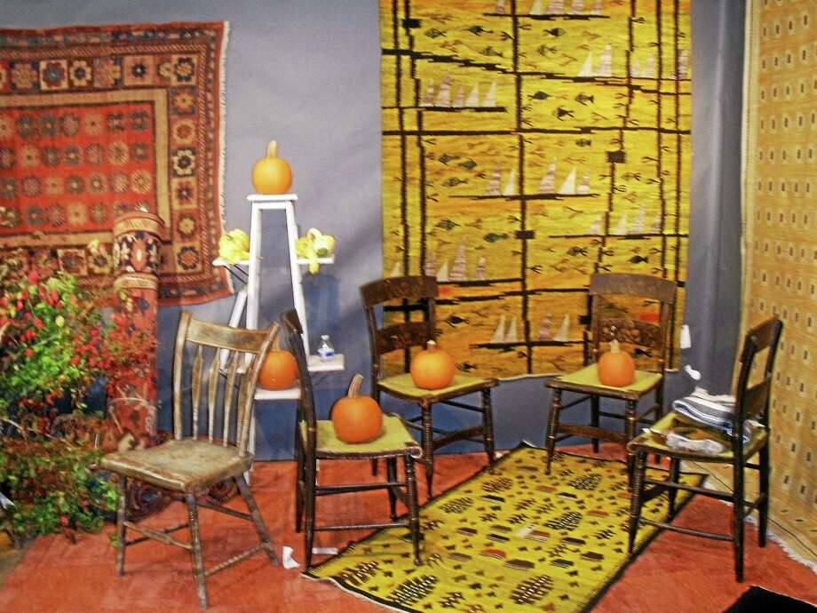 Photographs by Stephen Underwood Antique dealers assembled an impressive display of antiques ranging from vintage to 20th century items including furniture, glassware, paintings, rugs and much more. Photo: Journal Register Co.