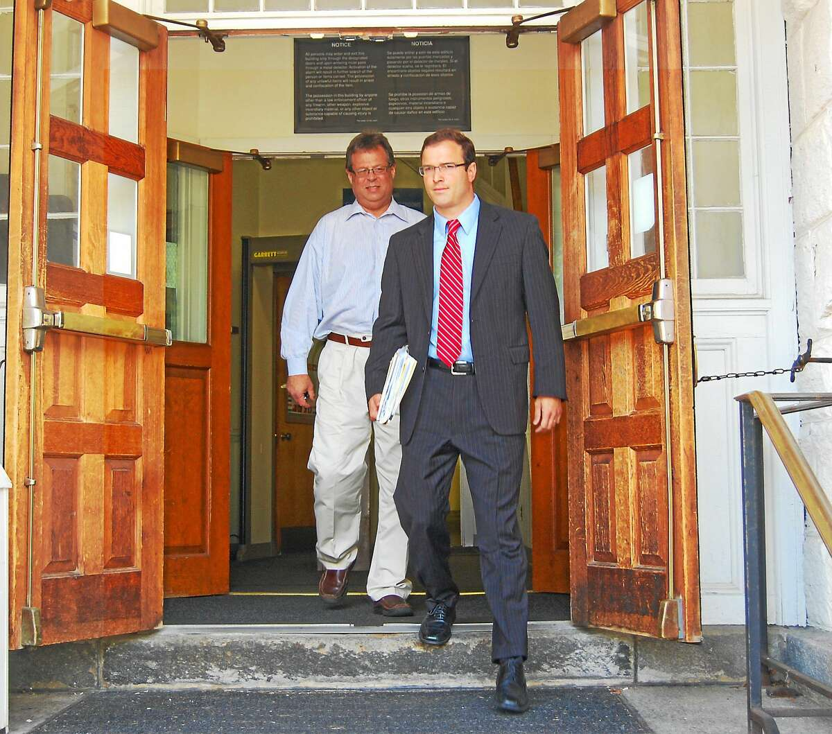 Henry Centrella walks behind his attorney, Robert Dwyer, as they exit Litchfield Superior Court in July 2013.