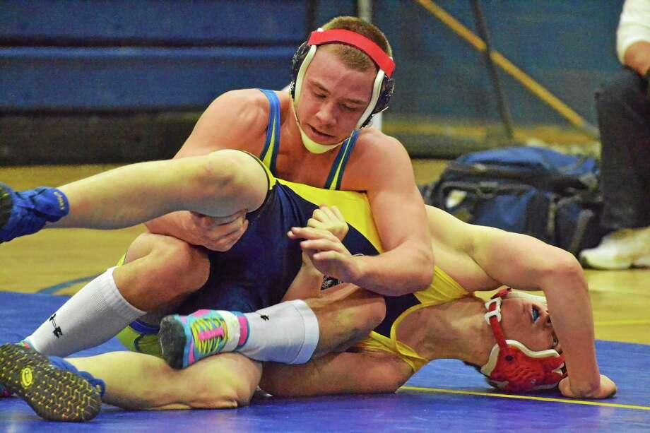 Logan Smith wrestles against Wolcott Tech earlier this season. Photo: Pete Paguaga — Register Citizen
