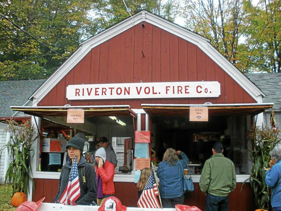 Photos by Stephen Underwood Riverton Fair guests warm up with coffee at the fire company booth on Saturday, The annual fair continues Sunday. Photo: Journal Register Co.