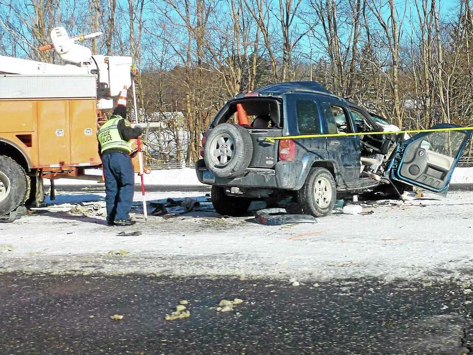 The scene of a fatal accident on Route 8 northbound at the exit 44 off-ramp in Torrington on Friday, where an SUV collided with a state DOT truck. Photo: Ryan Flynn—Register Citizen