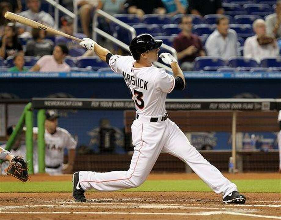 Miami Marlins' Jake Marisnick follows through on a second-inning home run against the New York Mets in a baseball game Wednesday, July 31, 2013, in Miami. The Marlins won 3-2. (AP Photo/El Nuevo Herald, Pedro Portal) MAGS OUT Photo: AP / El Nuevo Herald