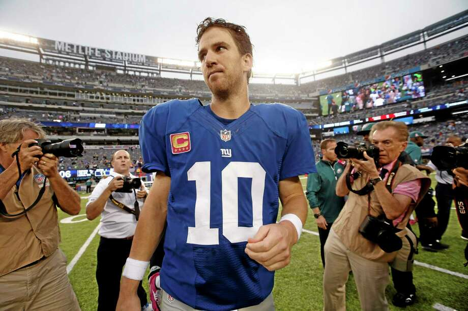 Giants quarterback Eli Manning leaves the field after Sunday's loss to the Eagles. Photo: Kathy Willens — The Associated Press  / AP