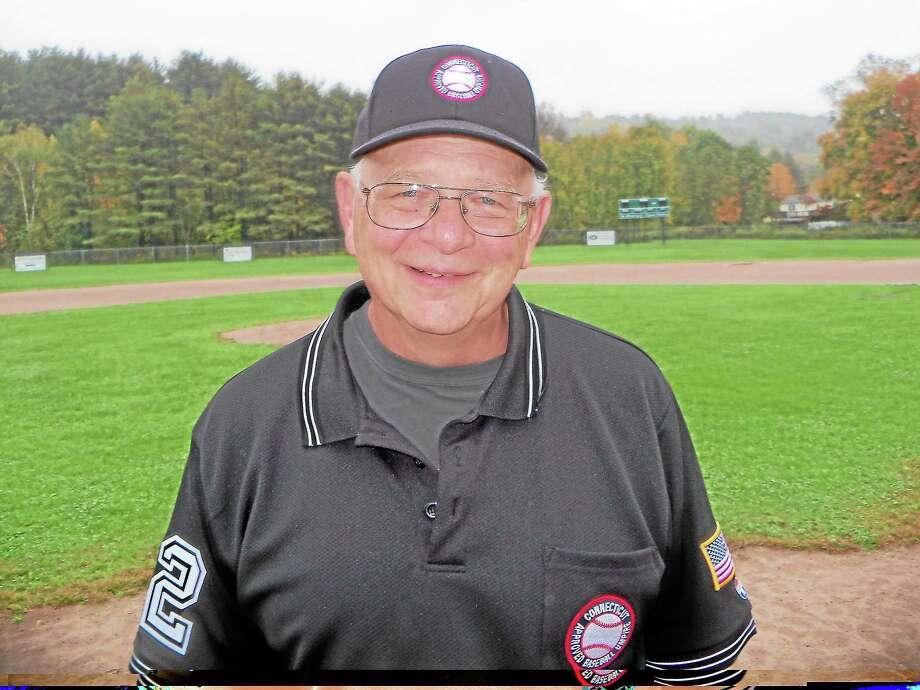 Umpire Mike McHugh survived a heart attack on the baseball field at Torrington High School six months ago. Now he's back umpiring fall baseball. Photo: Peter Wallace — Register Citizen