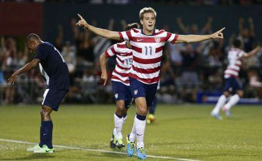 United States' Stuart Holden, left, celebrates his goal with Landon Donovan, right, and another teammate during the second half of their CONCACAF Gold Cup soccer game against Belize in Portland, Ore., Tuesday, July 9, 2013. The U.S. won 6-1. Photo: AP / The Oregonian