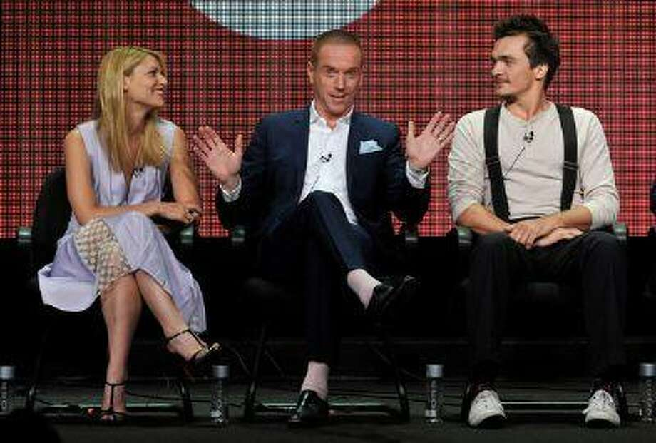 "From left, Claire Danes, Damian Lewis and Rupert Friend participate in the ""Homeland"" panel at the Showtime Summer TCA on Monday, July 29, 2013, at the Beverly Hilton hotel in Beverly Hills, Calif. (Photo by Chris Pizzello/Invision/AP) Photo: Chris Pizzello/Invision/AP / Invision net"