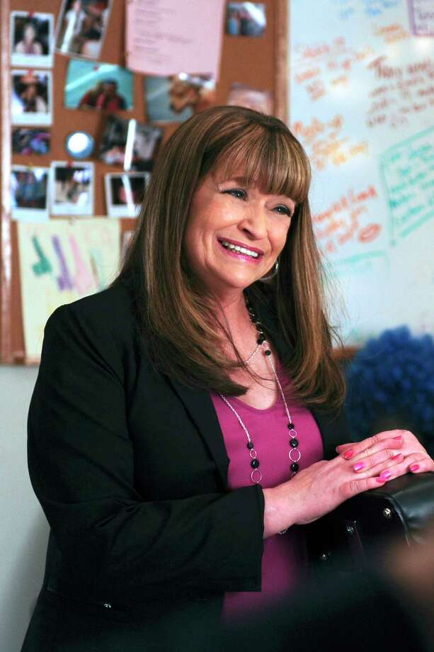 """This photo provided by NBC Universal shows Jan Hooks as Verna in season 4 of the television series, """"30 Rock.""""  Hooks, the former """"Saturday Night Live"""" cast member has died.  She was 57.  Hooks died Thursday, Oct. 9, 2014 according to her agent Lisa Lieberman. (AP Photo/NBCU Photo Bank, Ali Goldstein) Photo: AP / NBCU Photo Bank"""