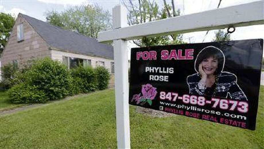 In this Sunday, June 16, 2013 photo, a home is for sale in Glenview, Ill. The National Association of Realtors reports on sales of previously occupied homes in June on Monday, July 22, 2013. (AP Photo/Nam Y. Huh) Photo: AP / AP