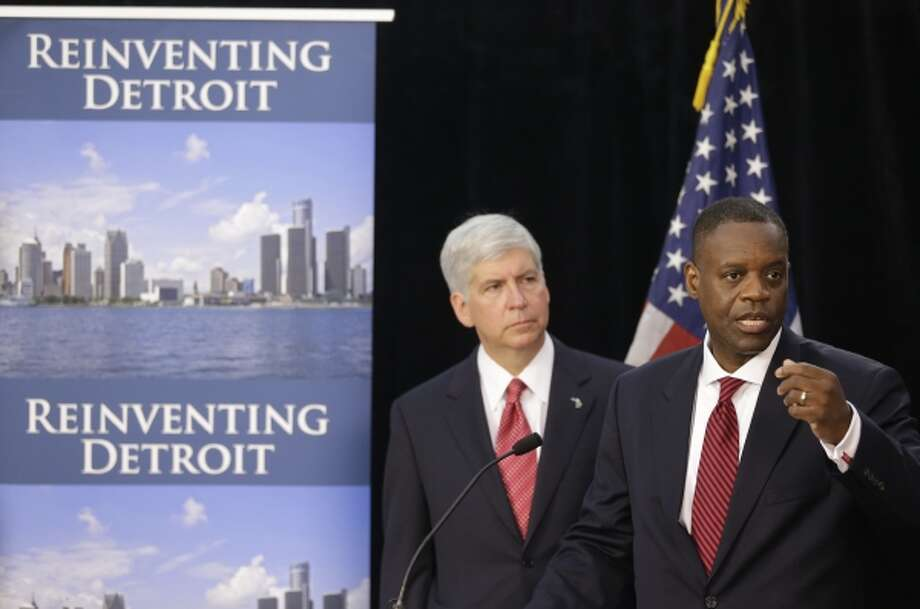 In a July 19, 2013, file photo state-appointed emergency manager Kevyn Orr, right, and Michigan Gov. Rick Snyder, address the media during a news conference in Detroit. Photo: AP / AP