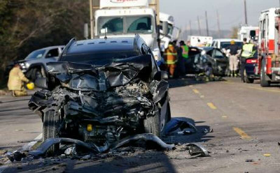 Emergency personnel work at the scene of a multi-car accident that caused one fatality on Hwy. 405 outside Donaldsonville, La., Tuesday, Dec. 17, 2013.