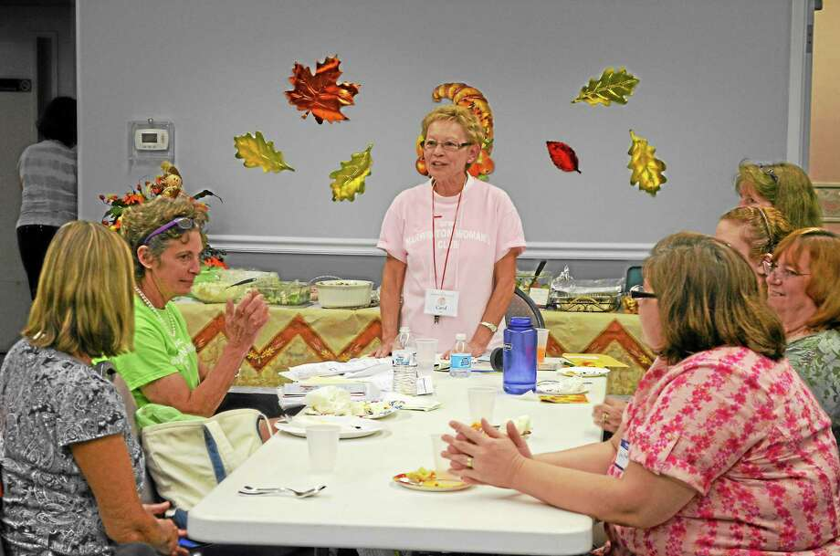 President Carol Buck led the Harwinton Women's Club's October meeting where they shared a potluck dinner and discussed upcoming fundraisers. Photo: Kate Hartman—Register Citizen