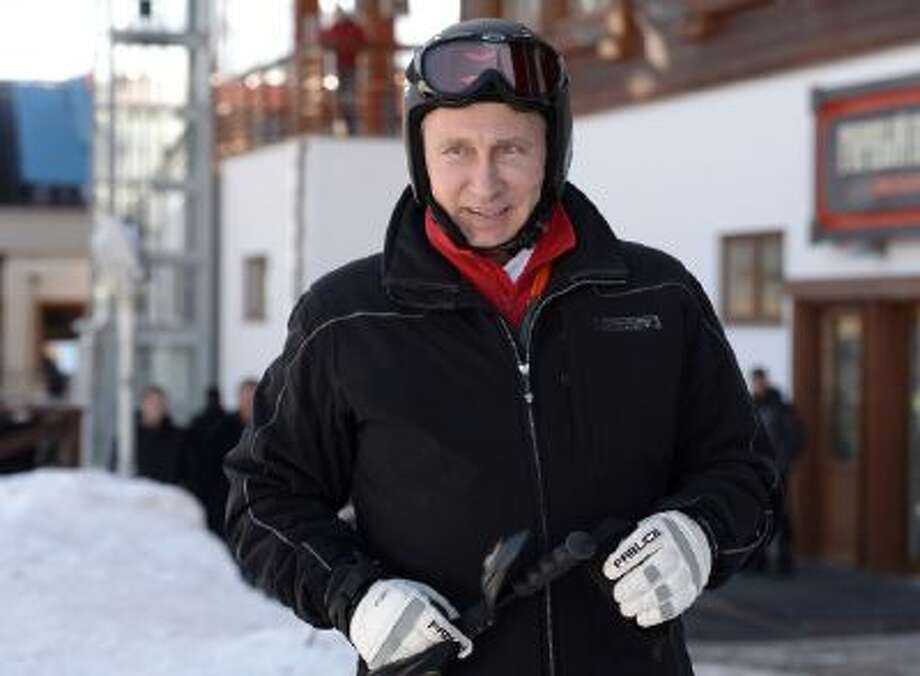 Russian President Vladimir Putin prepares to ski in the mountain resort of Krasnaya Polyana near the Black Sea resort of Sochi, southern Russia, Friday, Jan. 3, 2014.