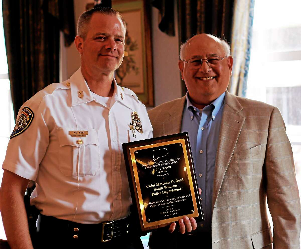 South Windsor Police Chief Matthew Reed, left, accepts the Bice Clemow Award from the Connecticut Council on Freedom of Information at The Hartford Club Wednesday. He is seen here with Mitch Pearlman.