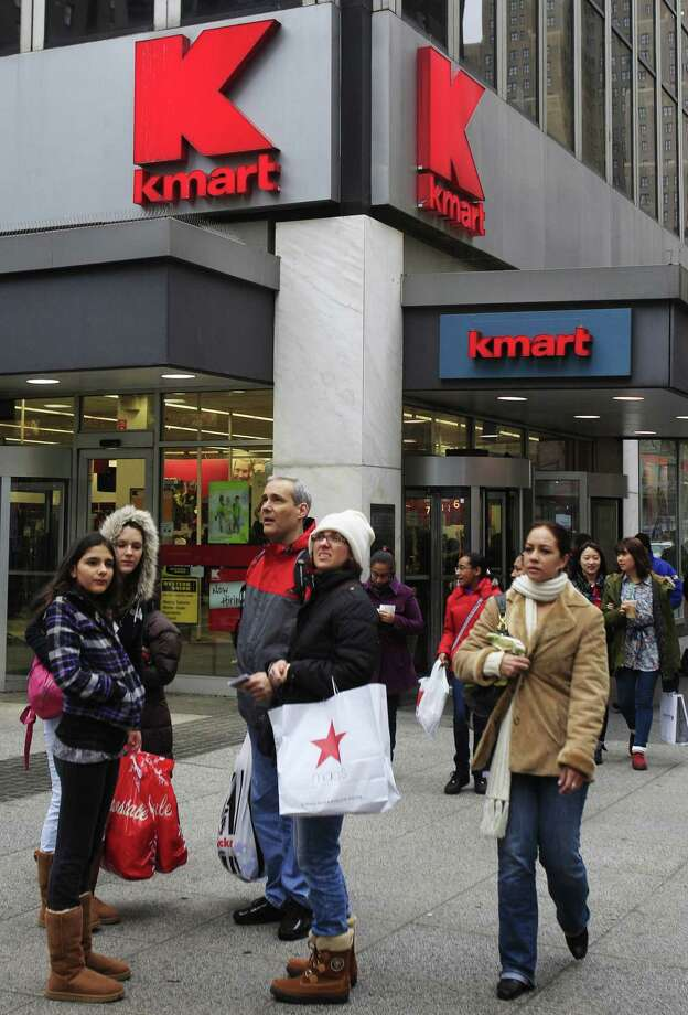 In this 2011 file photo, pedestrians pass a Kmart store location in New York. On Friday, Sears Holdings Corp. announced that it detected a data breach at its Kmart stores that started in August 2014, affecting certain customers' credit and debit card accounts. The data theft at Kmart is the latest in a string of data thefts that have hit several big retailers, including Target, Supervalu and Home Depot. Photo: Associated Press  / AP