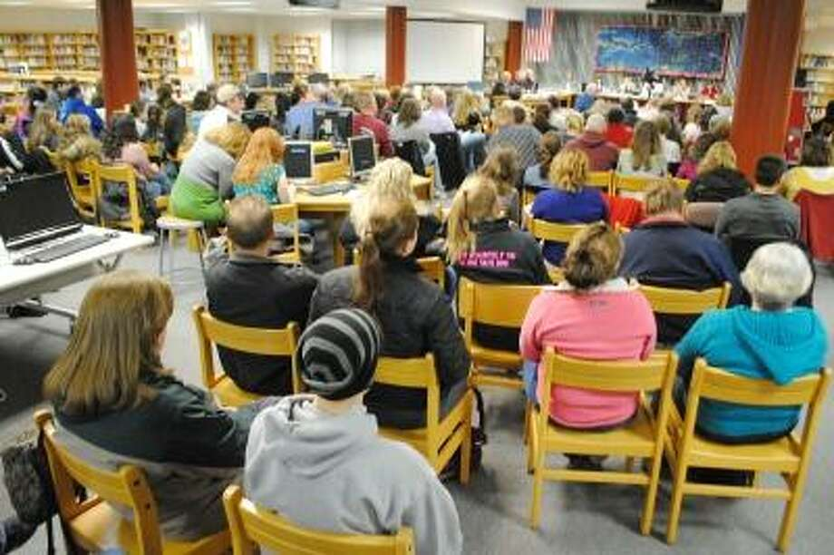 A crowd of more than 100 people gathered in Torrington High School library to hear Superintendent Cheryl Kloczko's proposed budget. (Jessica Glenza / Register Citizen)
