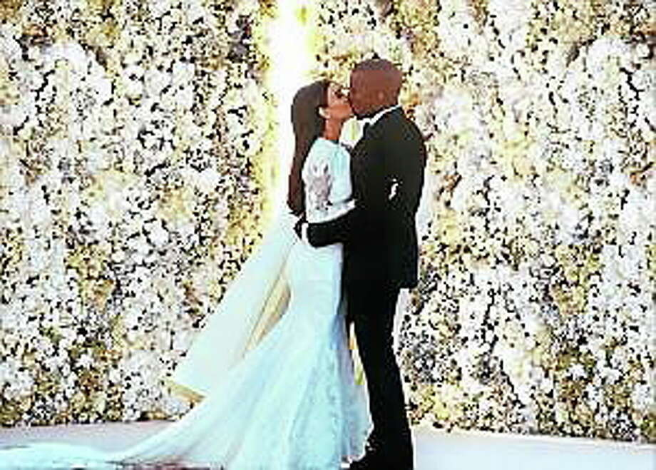 Kanye West says he spent four days retouching his wedding photo with Kim Kardashian because photographer Annie Leibovitz backed out at the last minute. Photo: (Kim Kardashian Via Instagram)