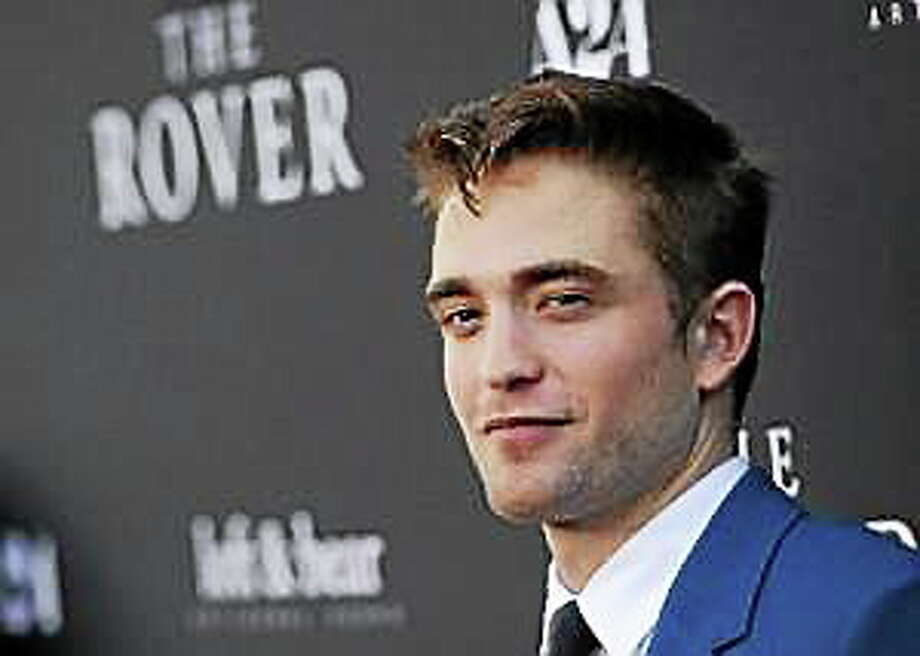 "Robert Pattinson, a cast member in ""The Rover,"" poses at the U.S. premiere of the film on Thursday, June 12, 2014, in Los Angeles. Photo: (Chris Pizzello — The Associated Press)"