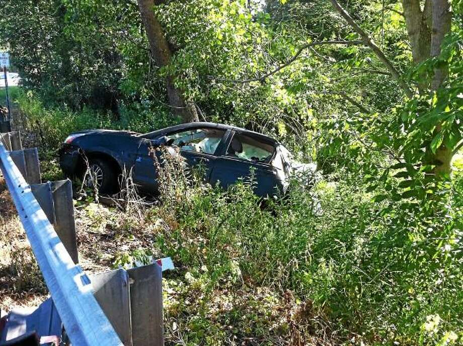 One driver sustained minor injuries Monday afternoon after his car veered off the side of Route 63 in Litchfield. (Viktoria Sundqvist - Register Citizen)