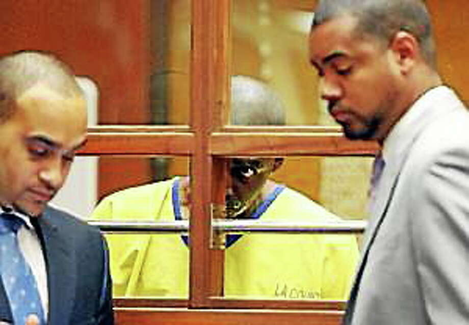 Actor Michael Jace, center, appears in court for his arraignment on murder charges June 18, 2014, in Los Angeles, California. Jace is charged with the May 19 shooting death of his wife April Jace. Photo: (Nick Ut — Getty Images)