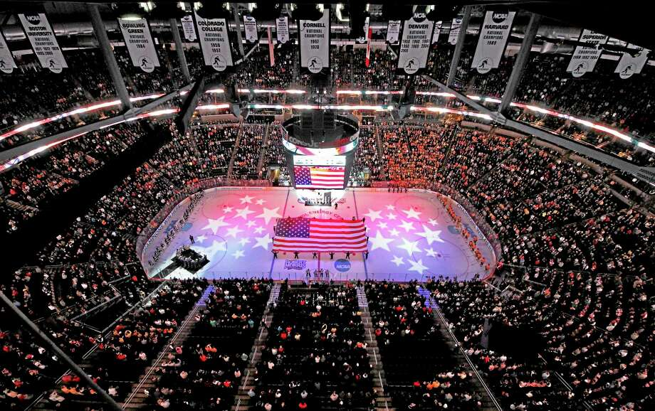 The national anthem is played at the Consol Energy Center in Pittsburgh before last year's national championship game between Yale and Quinnipiac. Register columnist Chip Malafronte clears up some of the confusion that surfaced when news broke that Quinnipiac is bidding to bring the Frozen Four to Orlando. Photo: Gene Puskar — The Associated Press  / AP
