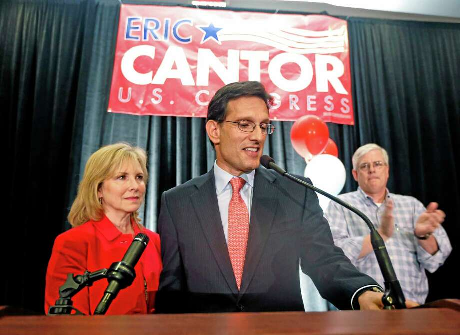 Congressman Eric Cantor, R-Va.,  stands beside his wife Diana, left,  and delivers a concession speech at his election night party in Richmond, Va., Tuesday, June 10, 2014. Cantor lost the GOP primary to tea party candidate Dave Brat.  (AP Photo/Steve Helber) Photo: AP / AP