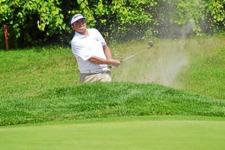 Jeff Curl shoots out of the bunker on the second hole during the second round of the Connecticut Open. Pete Paguaga - Register Citizen