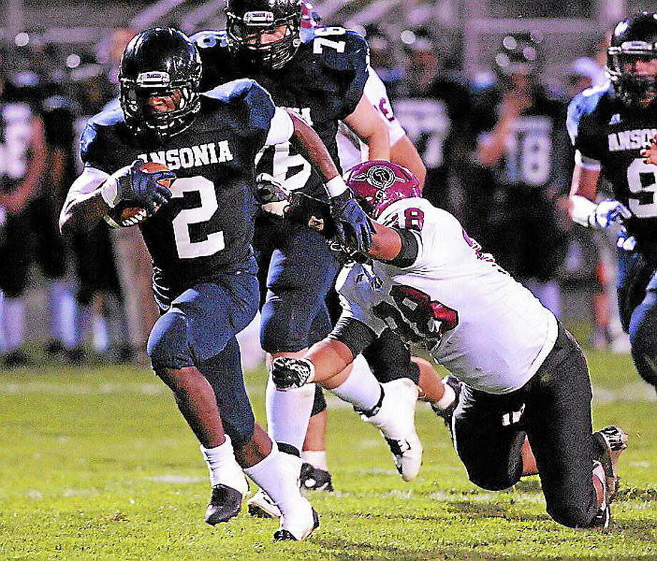 Ansonia's Arkeel Newsome says he's still committed to UConn, despite the recent firing of head coach Paul Pasqualoni. Photo: Peter Casolino — Register