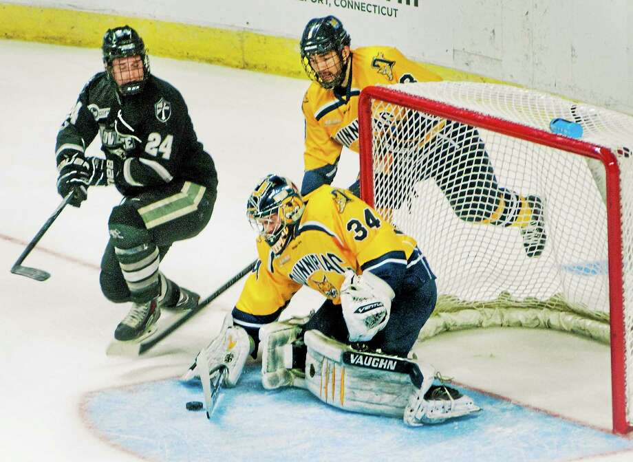 Quinnipiac goalie Michael Garteig and the Bobcats' defense will have to hold down the fort while the team's young forwards get up to speed. Photo: Melanie Stengel — Register File Photo  / MELANIE STENGEL