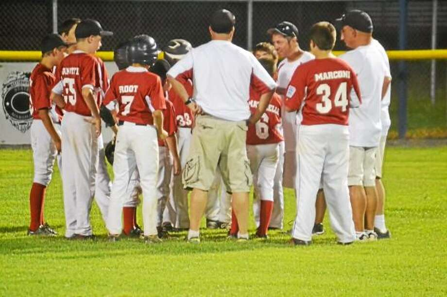Pete Paguaga - Register Citizen  Torrington's manager Chris Root talks to his team after the series ending loss to Fairfield.