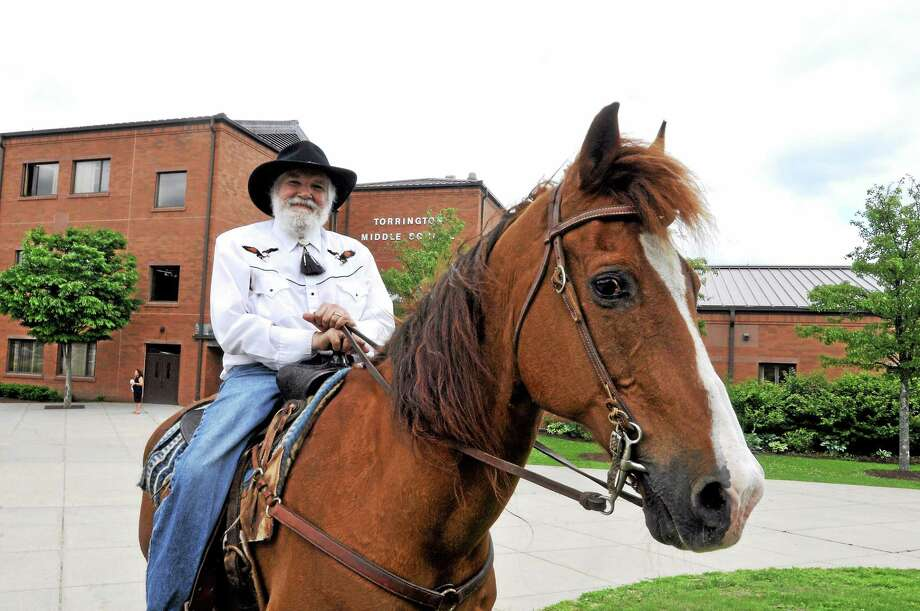 Torrington Middle School music teacher Matt Valenti ended his forty year teaching career today by waving farewell to students from atop of his horse on the last day of school Wednesday. Photo: Laurie Gaboardi — The Register Citizen