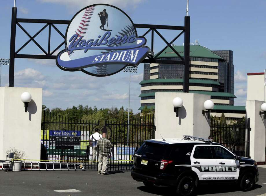 Montclair State University police officials investigate the main entrance to the Yogi Berra Stadium after a reported break-in on Wednesday in Montclair, N.J. Photo: Julio Cortez — The Associated Press  / AP