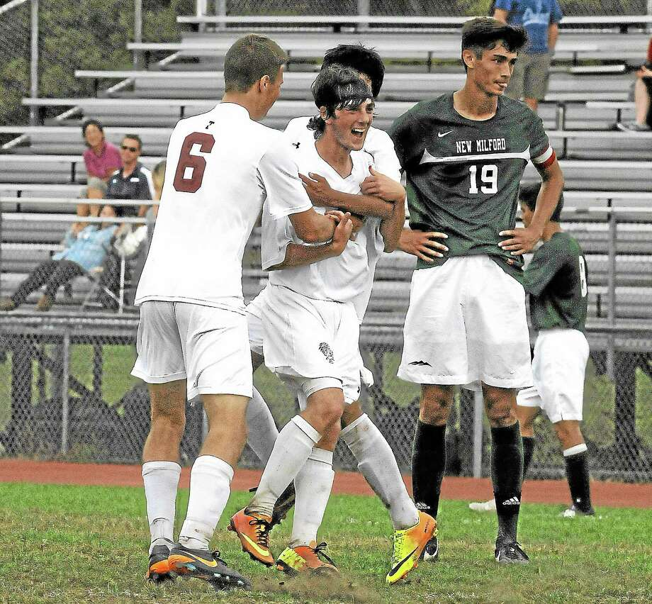 Shane Walker celebrates with Kevin Vaca and Chris Parrotta (6) after scoring the Red Raiders second goal of the game in its 2-0 win. Photo: Laurie Gaboardi — Register Citizen
