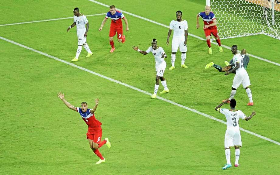 The United States' John Brooks, bottom left, celebrates scoring his side's second goal Monday during the group G World Cup match against Ghana at the Arena das Dunas in Natal, Brazil. Photo: Hassan Ammar ­— The Associated Press  / AP
