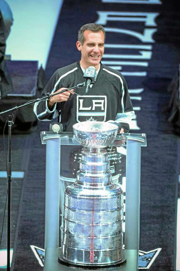 In this photo taken on Monday, Los Angeles Mayor Eric Garcetti talks to the crowd during the Los Angeles Kings' Stanley Cup championship rally at Staples Center. Mayor Garcetti used the F-bomb in declaring it a big day for LA, bringing 19,000 hockey fans to their feet, lighting up the Twitterverse in delight and leaving some folks scratching their heads, wondering just what the heck the normally soft-spoken elected official was thinking. Photo: David Crane — Los Angeles Daily News  / Los Angeles Daily News