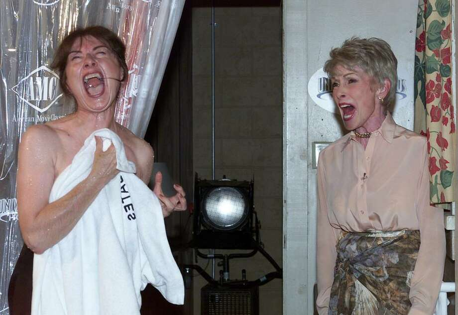"""File photo of Sue Pelinski of Park Ridge, Illinois, winner of the Universal Studios """"Best Psycho Shower Scene Scream"""" contest, and actress Janet Leigh (R) letting out a scream in the Bates Motel set during a recreation of the famous shower scene from the film """"Psycho,"""" during a photo opportunity August 1, 2000 at Universal Studios in Los Angeles. Hollywood movie star Janet Leigh, best known as the knife attack victim in Alfred Hitchcock's """"Psycho,"""" has died at the age of 77, CNN reported October 4, 2004. """"Janet Leigh died peacefully in her home Sunday afternoon,"""" Heidi Schaeffer, a spokeswoman for Leigh's daughter, actress Jamie Lee Curtis, was quoted as saying. REUTERS/Fred Prouser-Files  FSP/HB - RTRCGIG Photo: REUTERS / X00224"""