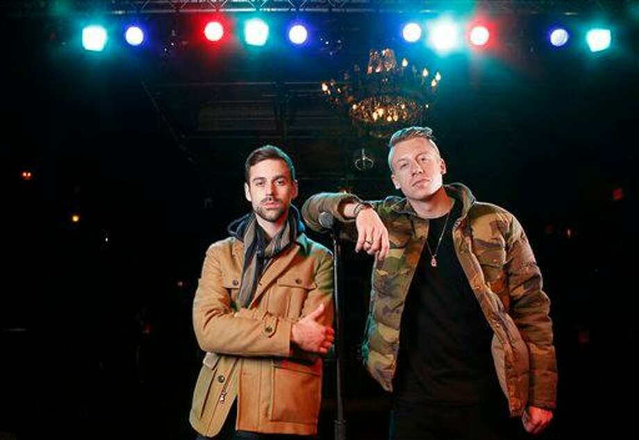 """FILE - In this Nov. 20, 2012 file photo, American musician Ben Haggerty, better known by his stage name Macklemore, right, and his producer Ryan Lewis pose for a portrait at Irving Plaza in New York.  Macklemore & Ryan Lewis feat. Wanz, """"Thrift Shop"""" (Macklemore) is the number one top streamed track for the United States on Spotify from Monday, March 4, 2013 to Sunday, March 10 (Photo by Carlo Allegri/Invision/AP, File) Photo: Carlo Allegri/Invision/AP / Invision"""