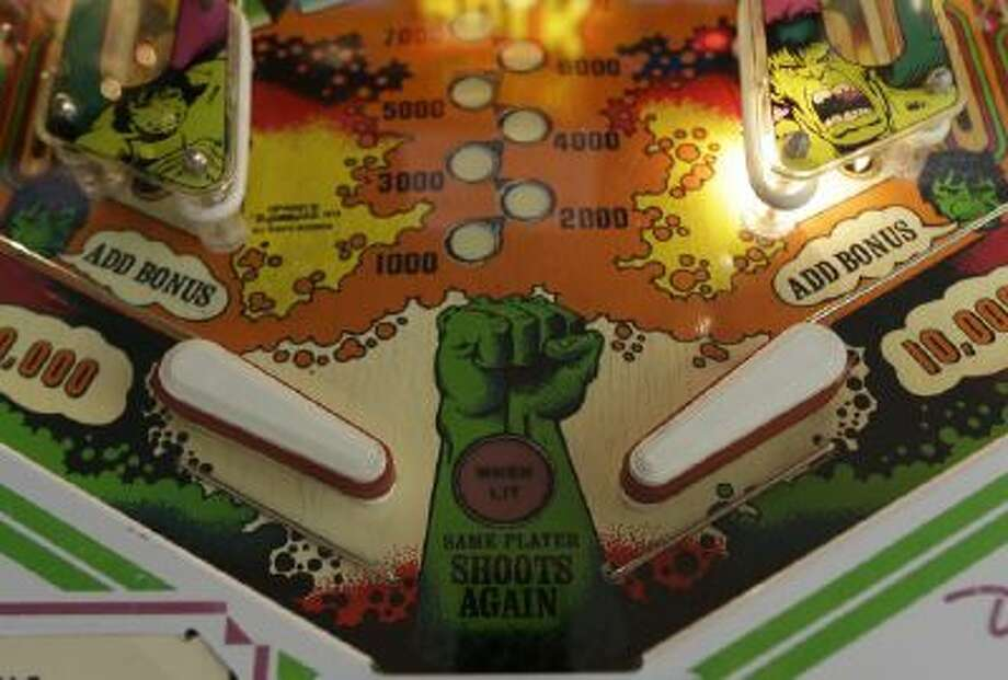 Flippers and bumpers are shown on the 1979 Incredible Hulk pinball machine at the Seattle Pinball Museum in Seattle.