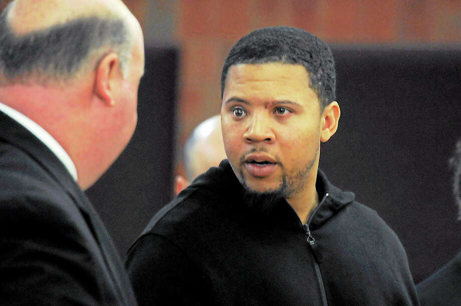 Alexander Bradley, right, talks with his attorney Robert Pickering during a court appearance at Hartford Superior Court on Friday. Bradley was directed to testify Tuesday before a Massachusetts grand jury in a double homicide investigation that has been linked to former New England Patriot Aaron Hernandez. A fugitive warrant was issued for Bradley last month when he did not appear for a hearing related to that case. Bradley was ordered held on $250,000 bond. Photo: Richard Messina — The Associated Press  / Pool The Hartford Courant
