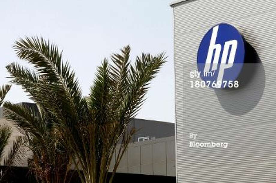 An 'HP' logo sits on display outside the Hewlett Packard Israel Ltd. production plant in Kiryat Gat, Israel, on Sunday, Sept. 15, 2013.