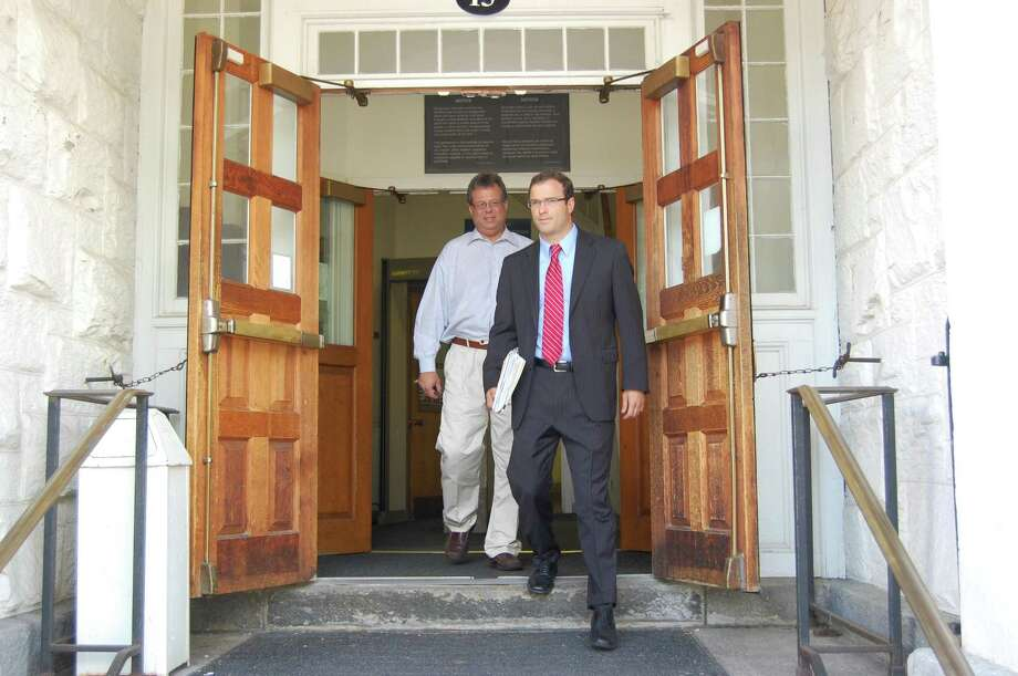 Henry Centrella, without tie, exits the Litchfield Superior Courthouse on Monday, July 29, 2013, behind his attorney, Robert Dwyer. Centrella, the former Winchester finance director, is accused of embezzling funds from the town. Tom Cleary - Register Citizen.
