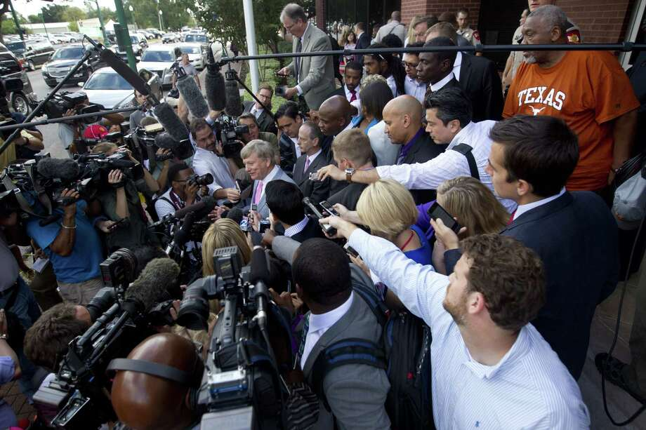 Houston attorney Rusty Hardin, center, speaks to the media after Minnesota Vikings running back Adrian Peterson appeared in court Wednesday in Conroe, Texas. Photo: Jason Fochtman — Conroe Courier  / Conroe Courier